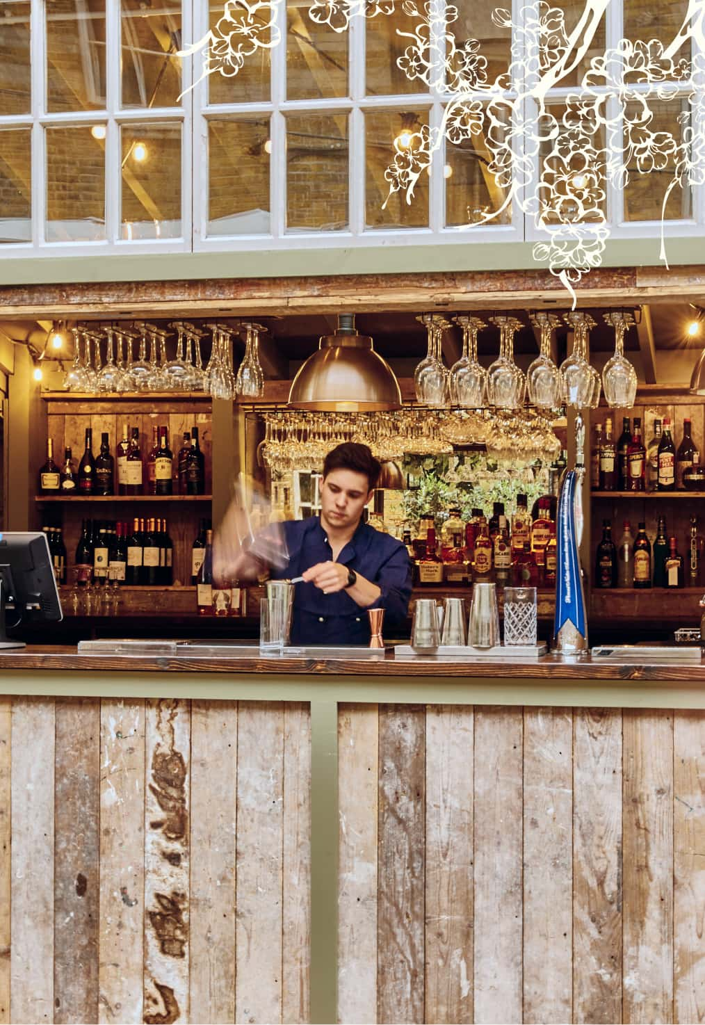A mixologist making making cocktails at the Courtyard bar in Stanley's Chelsea
