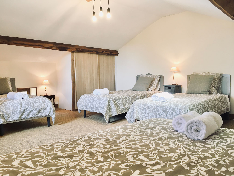 Chambre avec 4 lits simples