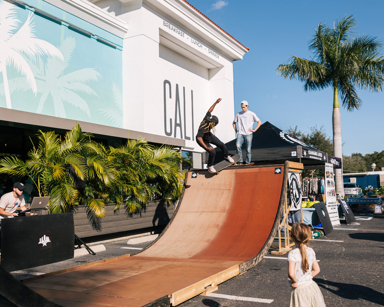 Skateboarding event outside of Cali restaurant