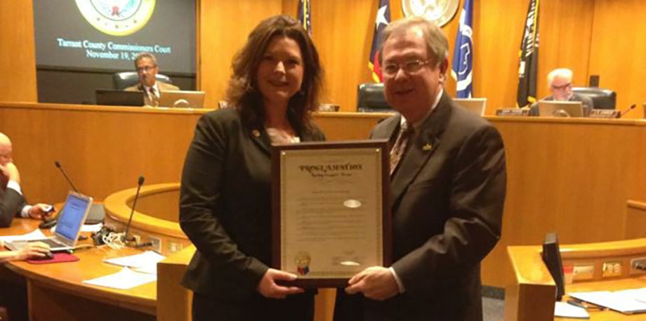 Leslie Barrows receiving a proclamation on National Adoption Day