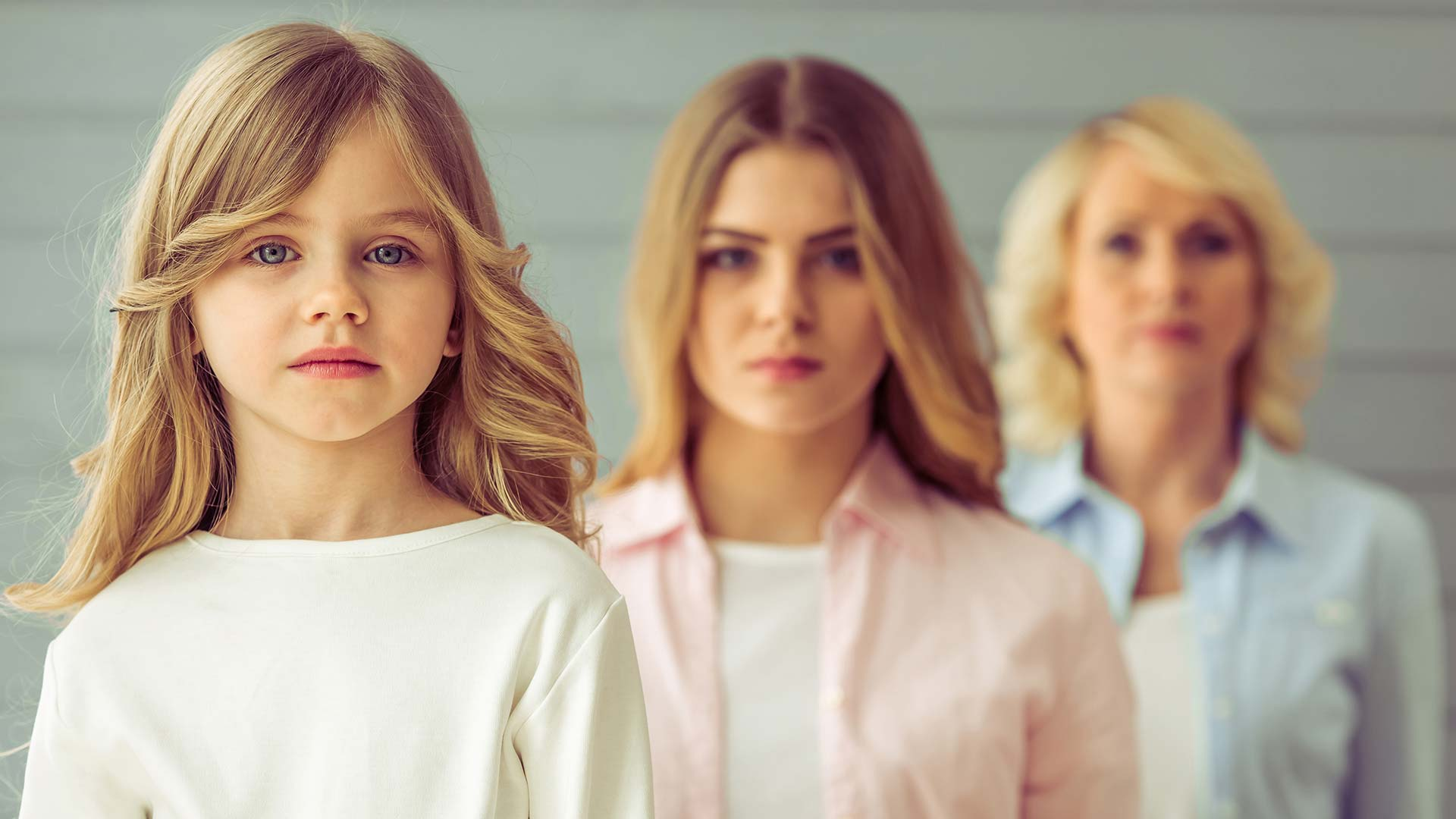 Family Law represented by three generations of women standing in front of each other.