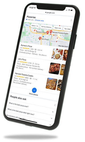 Phone with a mockup of Google local search page on the screen