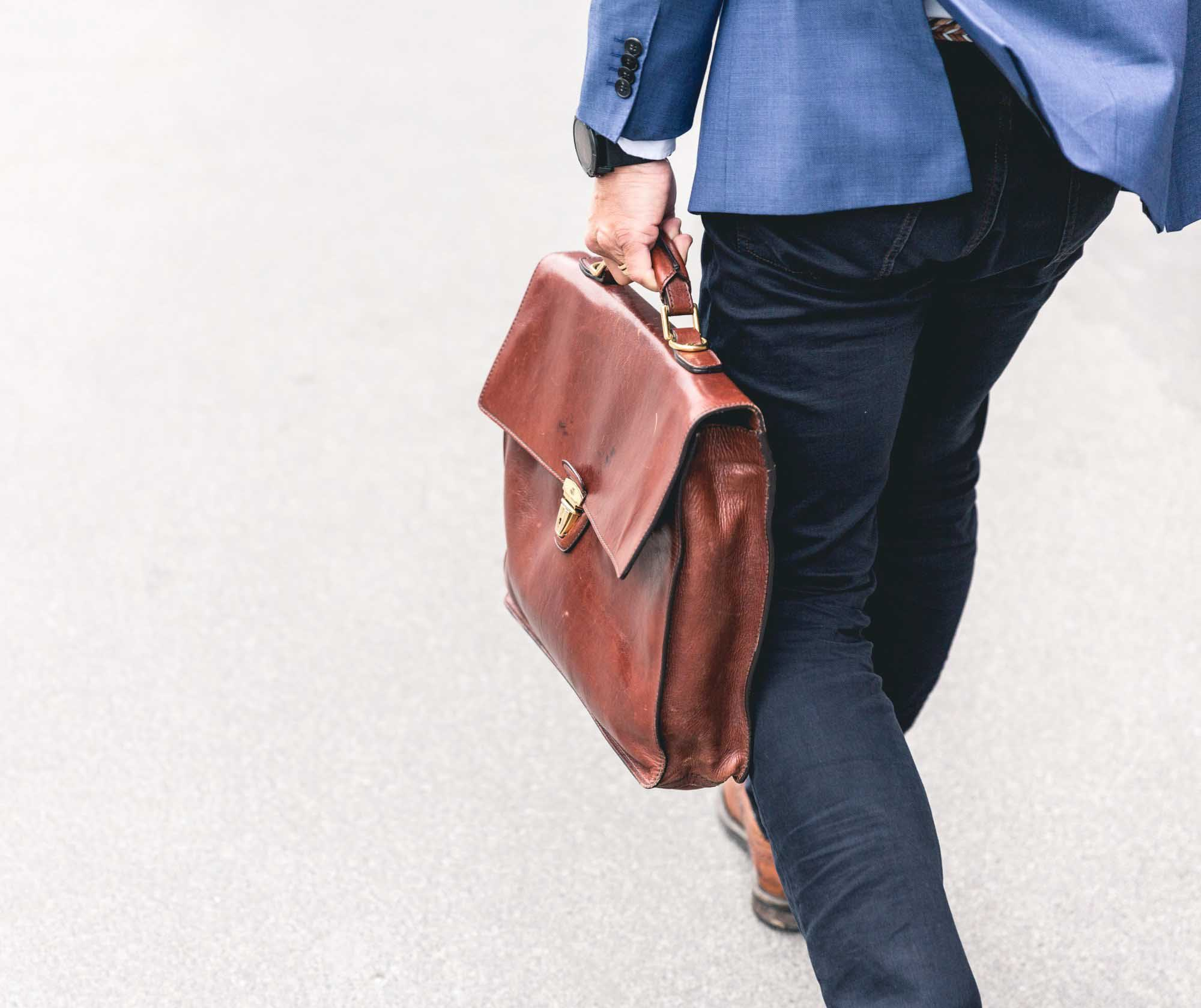 a man walking with a briefcase