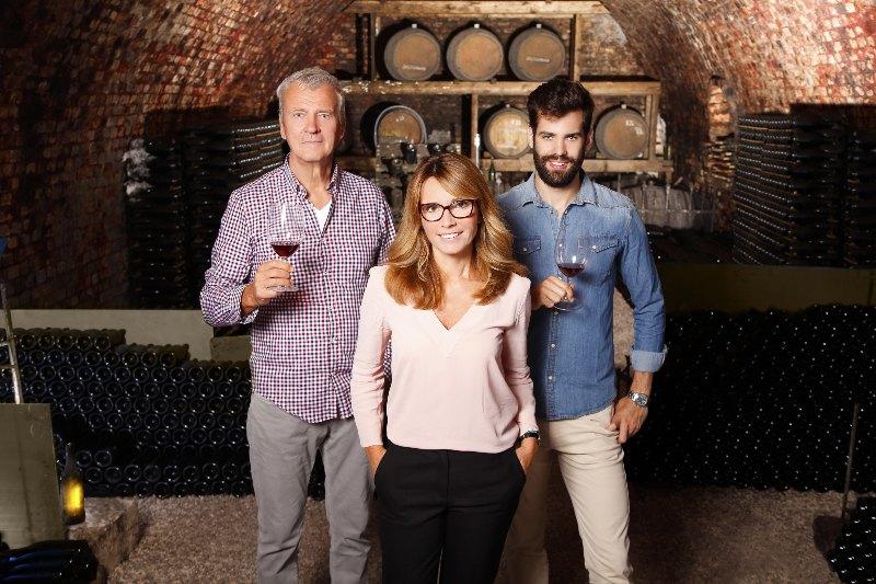 family in wine cellar