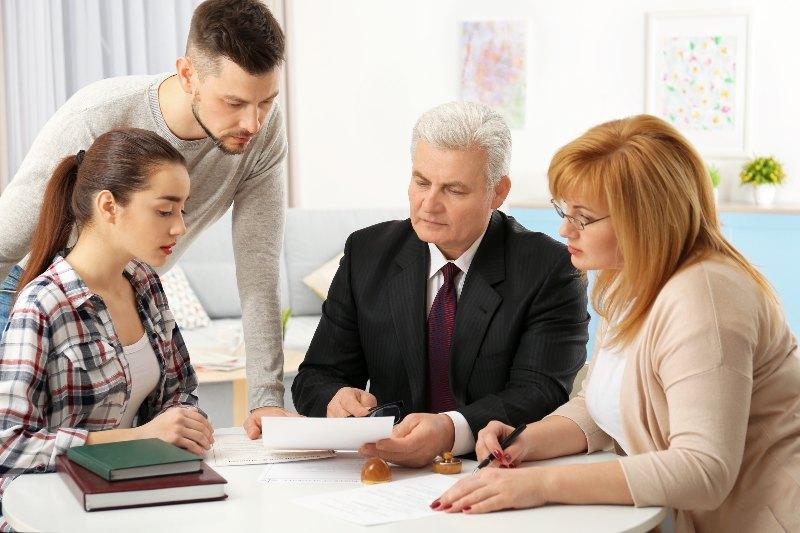 people looking at paperwork