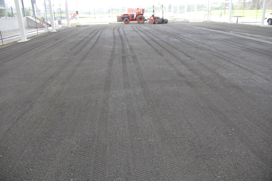 Final surface prep for multisport Artificial playing surface
