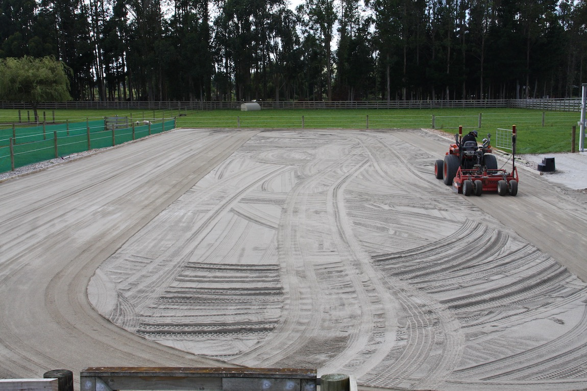Final levelling of equestrian dressage arena