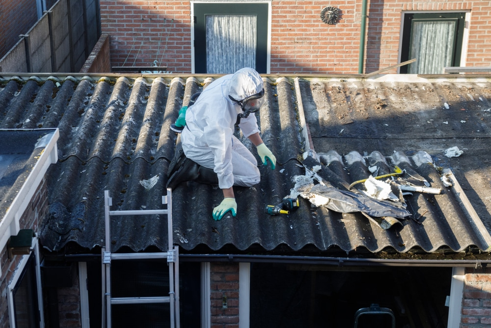Workers removing asbestos from the roof of a shed