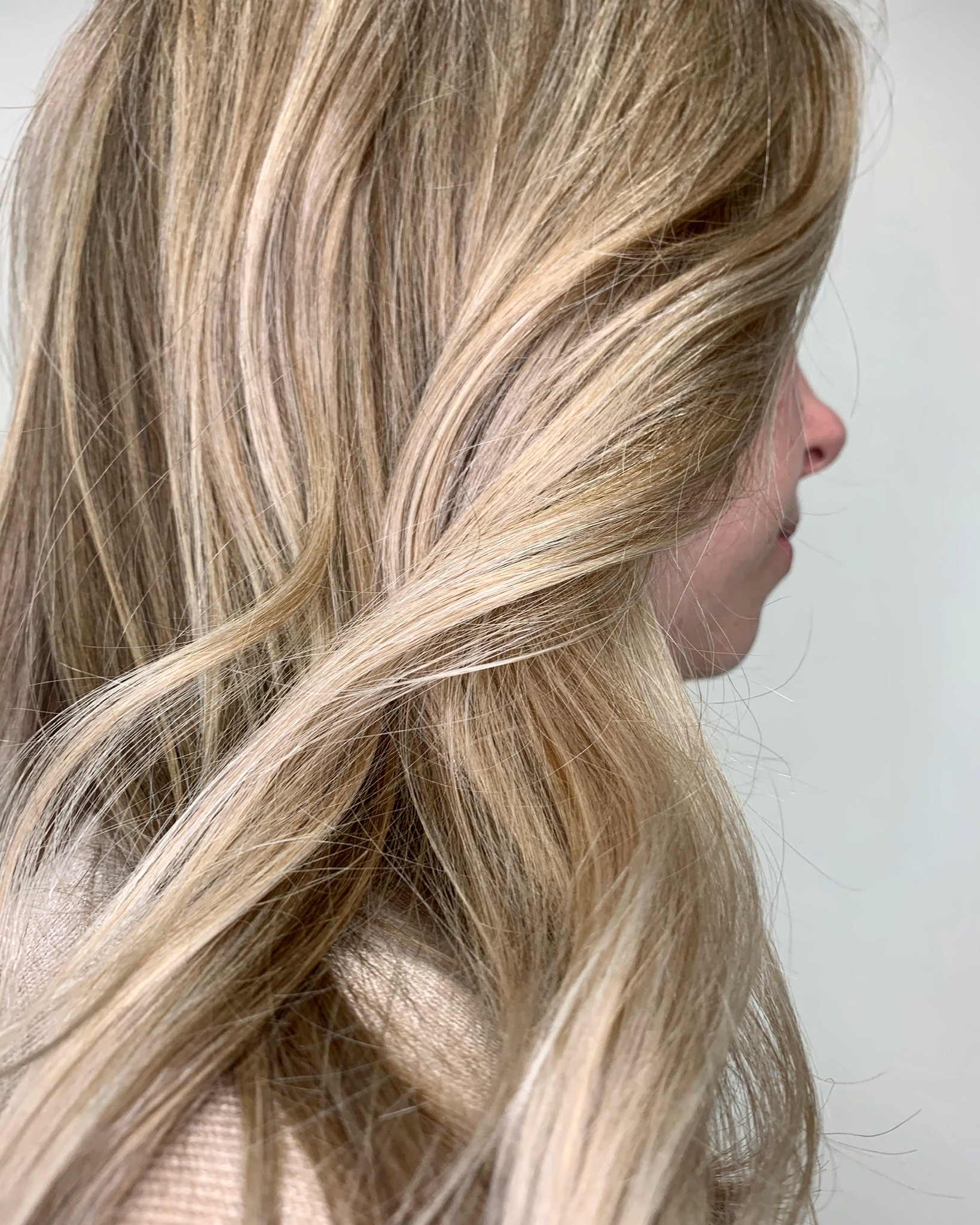 side view of woman with cascading blonde hair