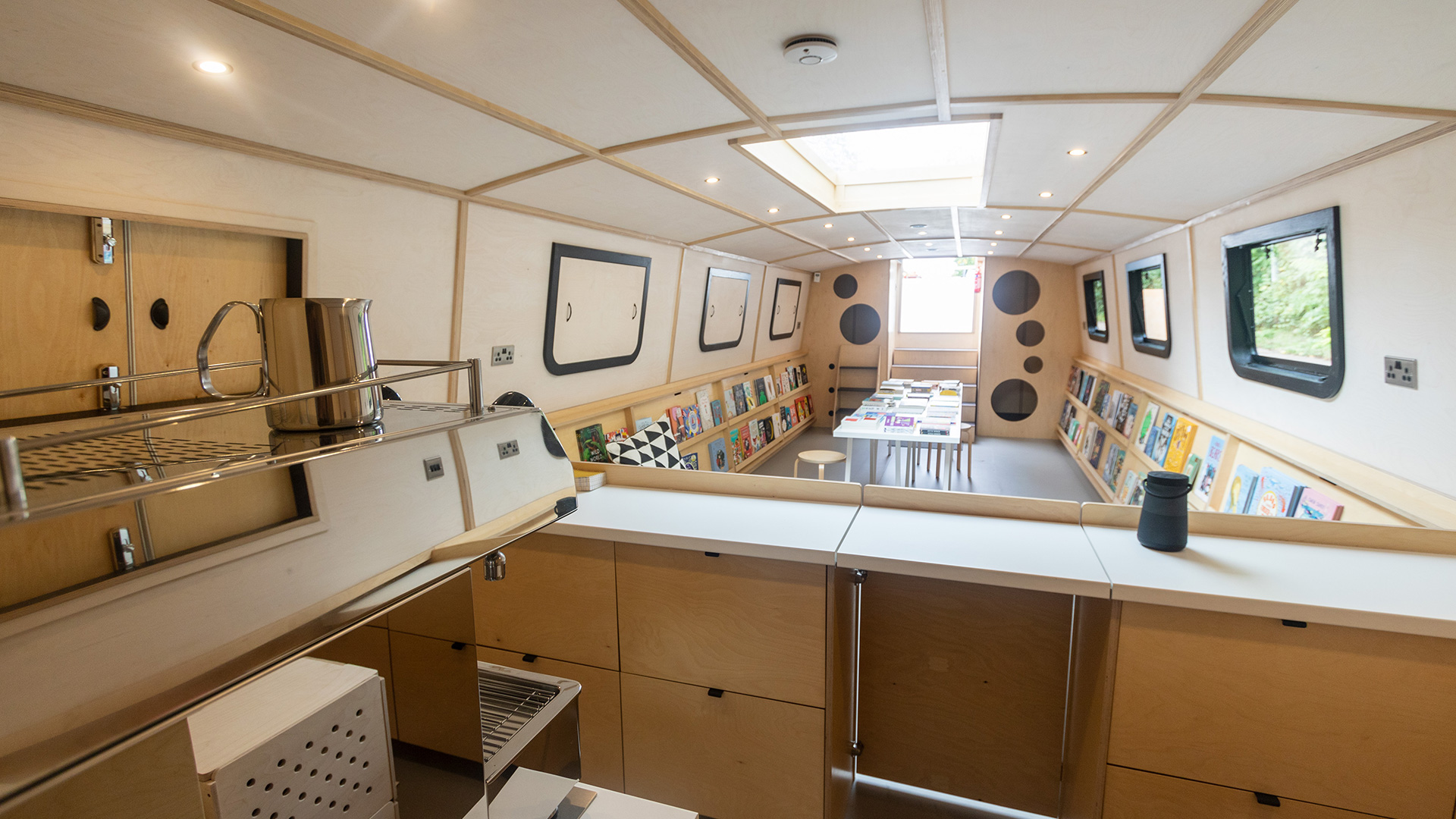 A floating bookshop and event space, specialising in illustrated books for children.