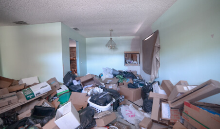 Trashed room filled with boxes