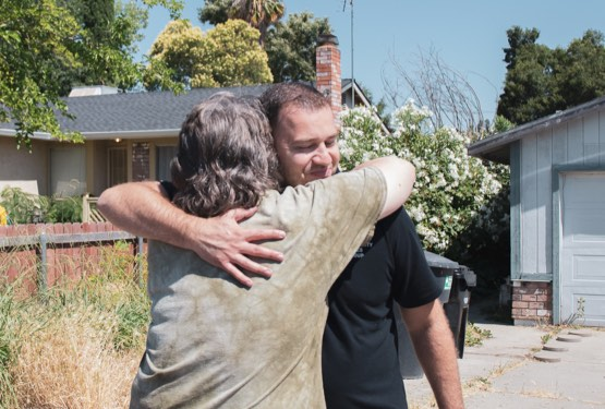 Client hugging PSG Expert in gratitude
