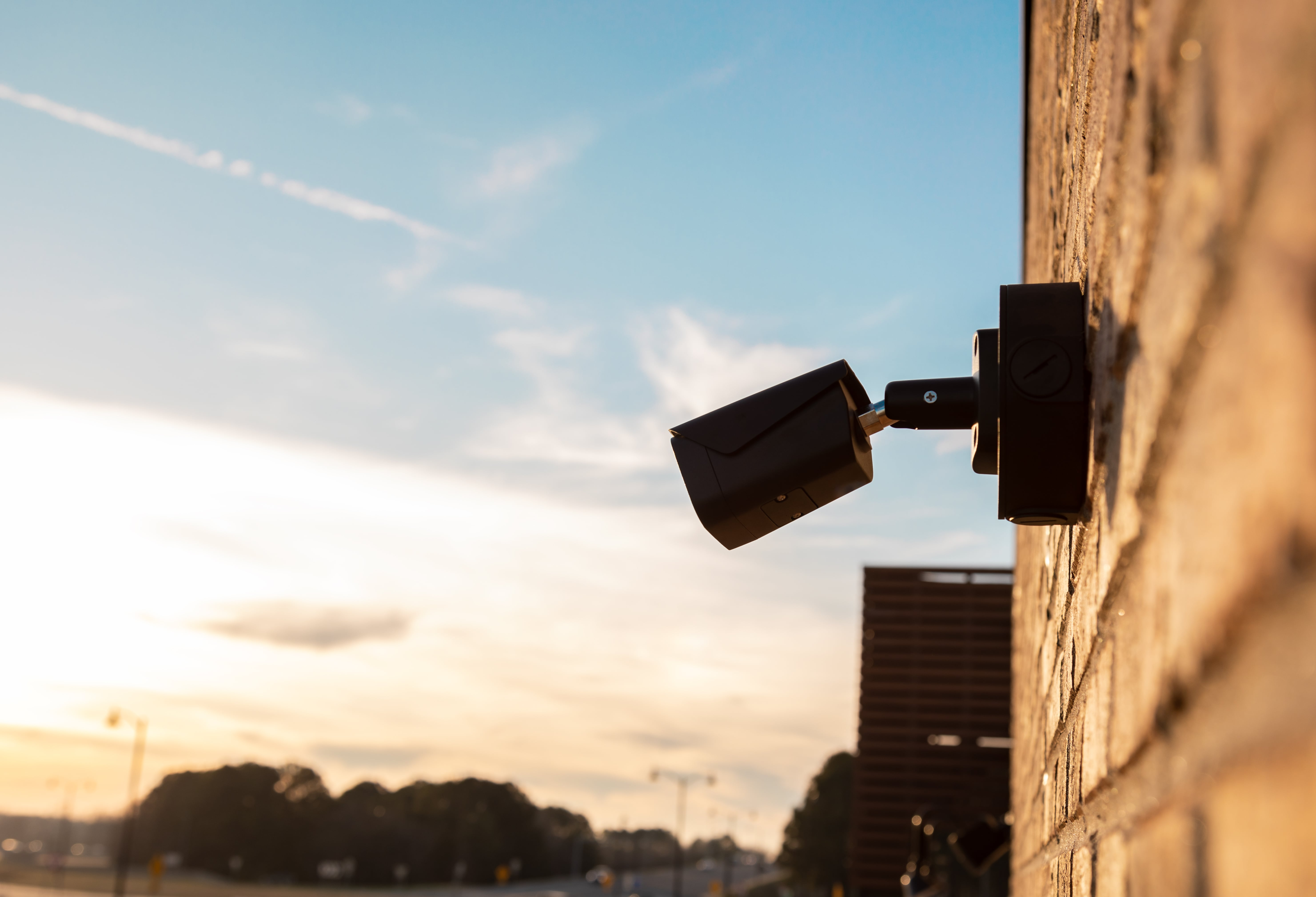 HD surveillance camera mounted to a wall outdoors