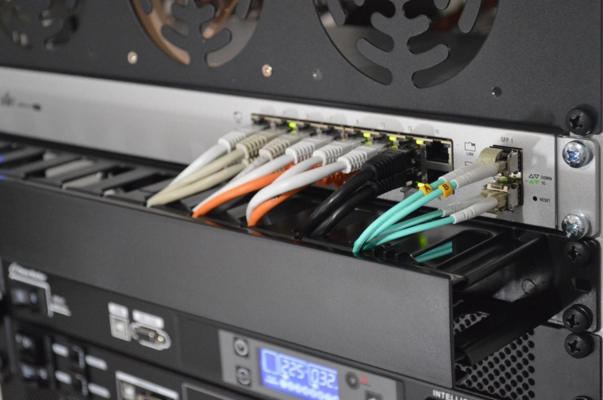 Network cables connect to switch and network rack