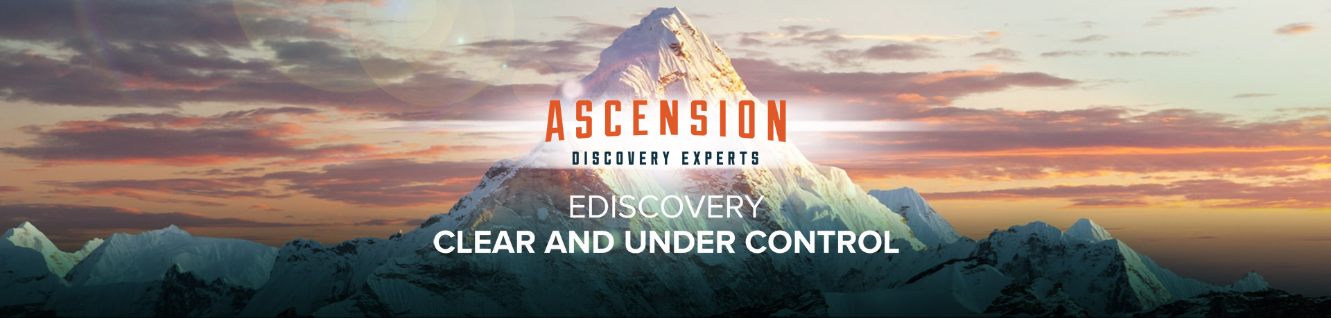 Ascension Discovery Experts hero image of a mountain with clouds in the background and the ADE logo in the fore-ground