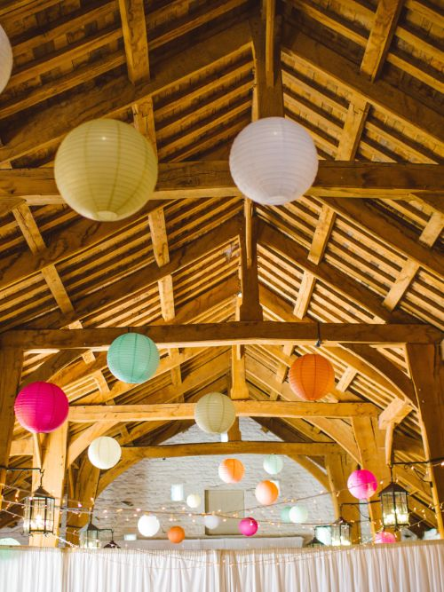 A function room decorated with balloons on the ceiling ready for a party
