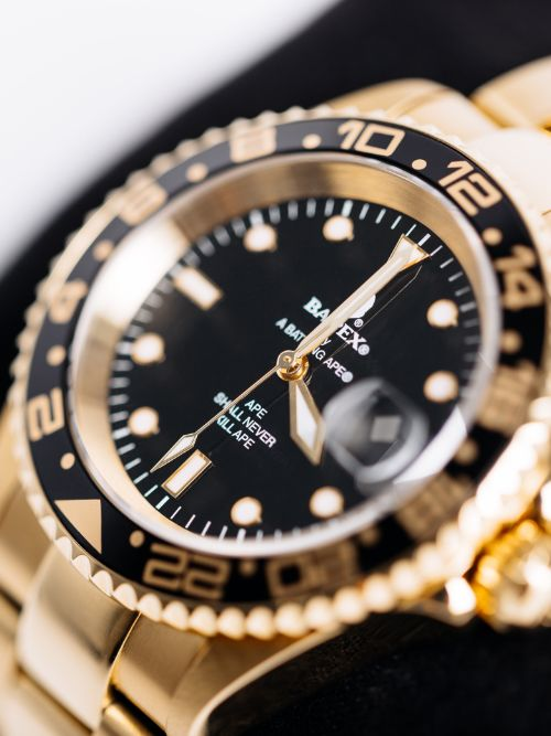 A men's gold Rolex watch being featured in a luxury product video