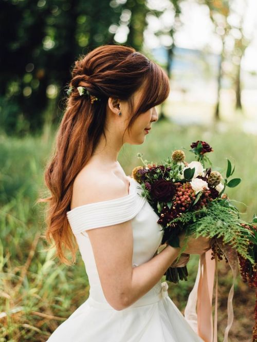 Bride holding flowers ready to walk down the aisle before being filmed at a civil wedding