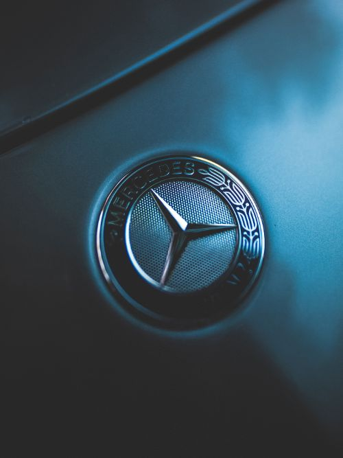 Light creatively cast across a Mercedes Benz car badge in a brand video for marketing