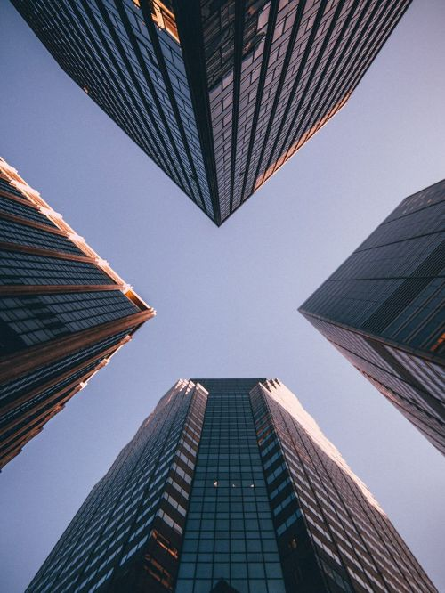 Creative photography of a city commercial district looking up at skyscraper office buildings