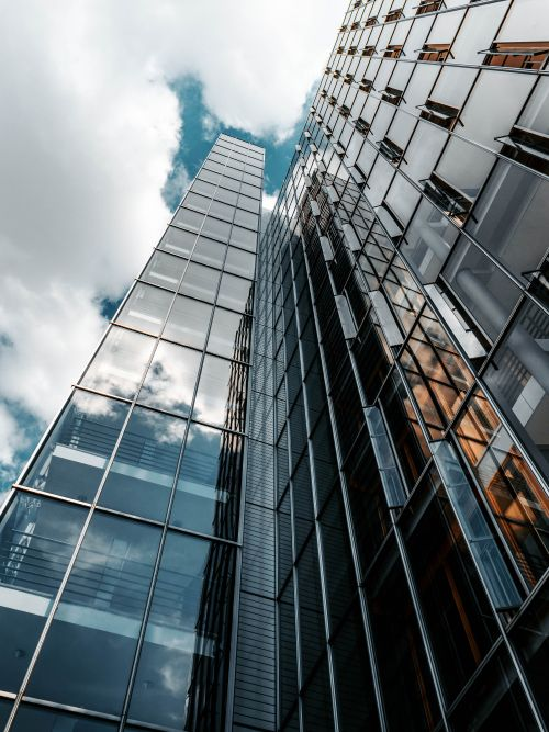 Shot of clouds passing over a tall glass office building for a commercial video shoot