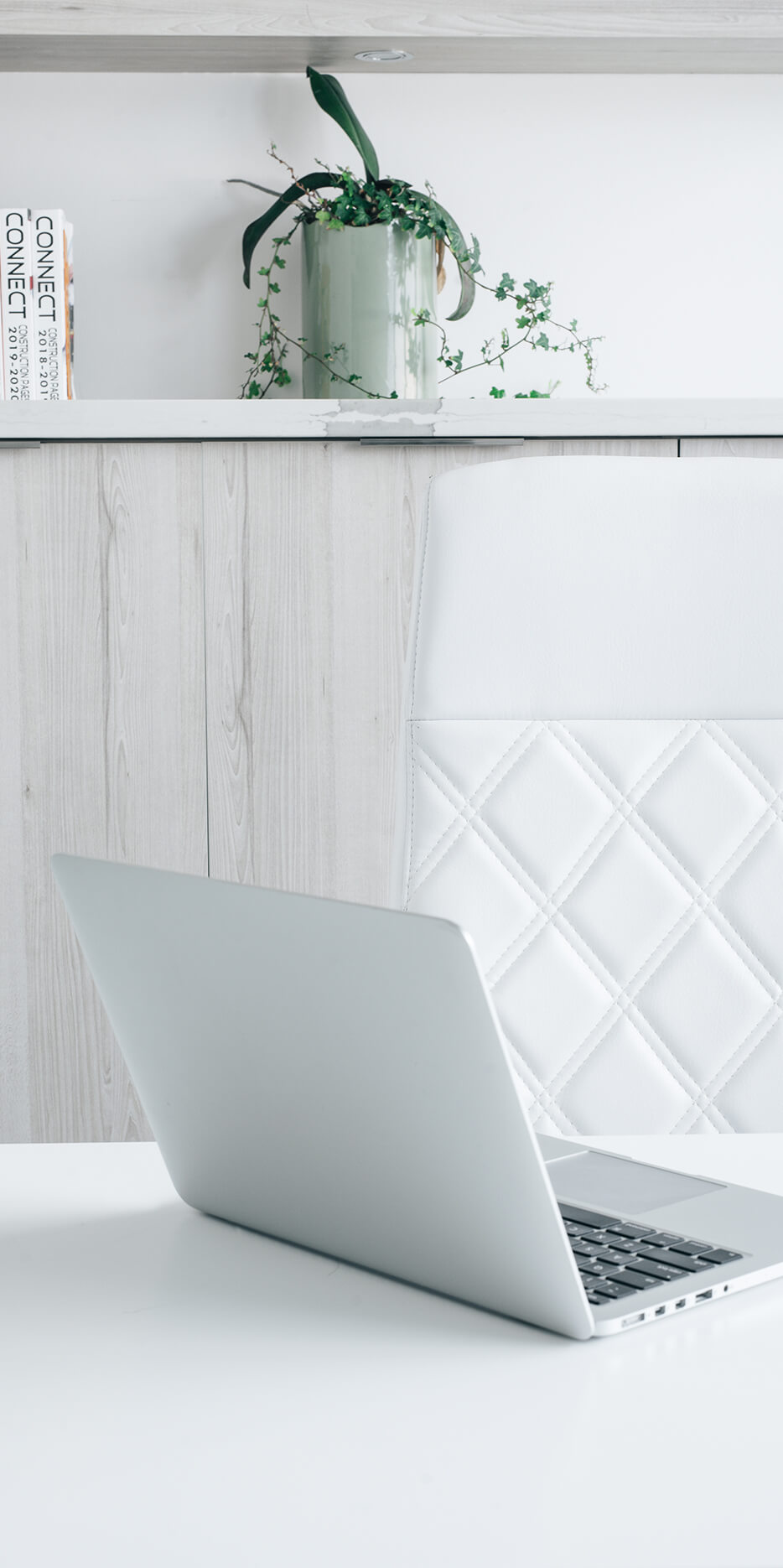 Laptop on a white table