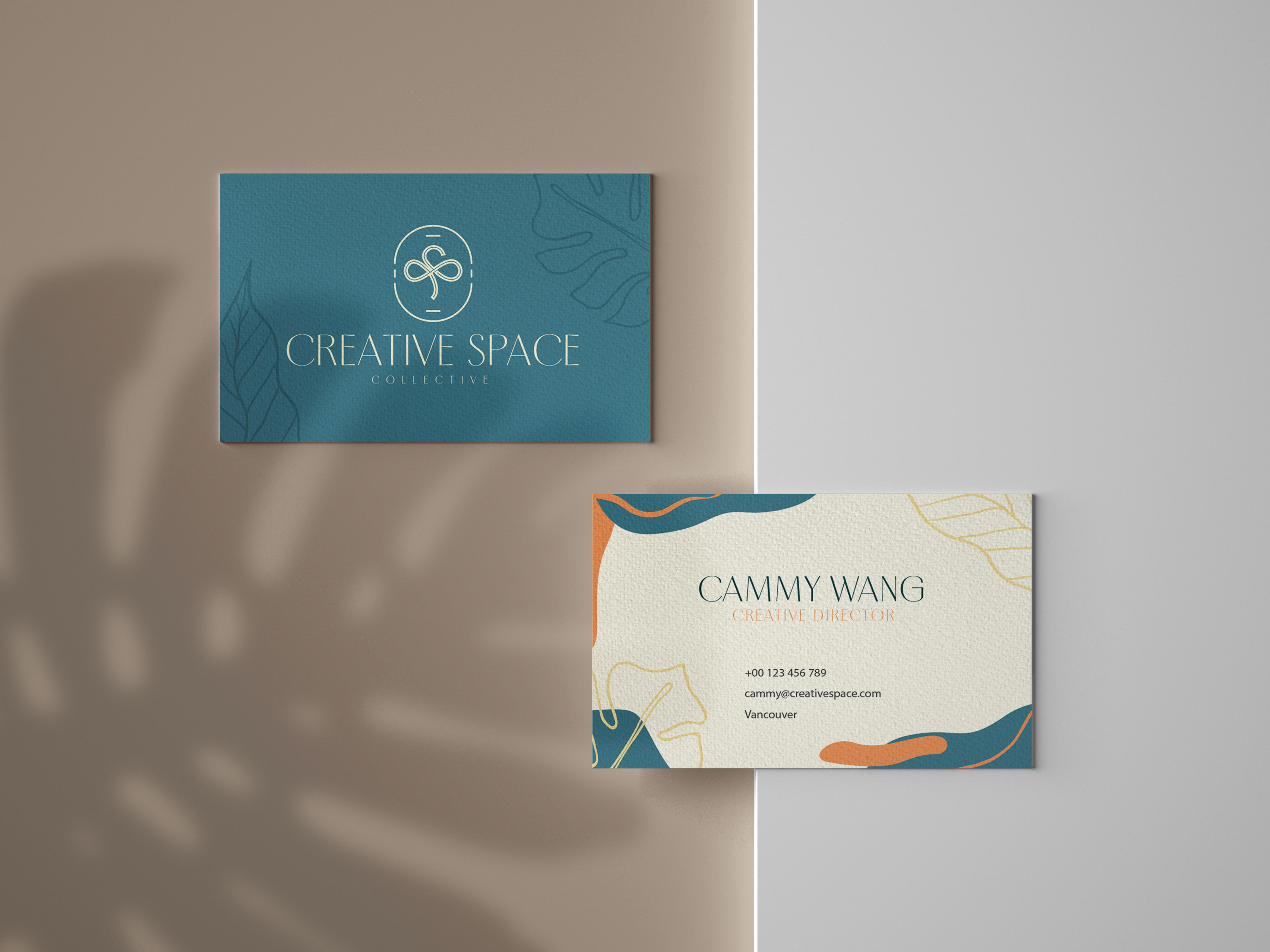 Top view of Creative Space business card featuring glover logo