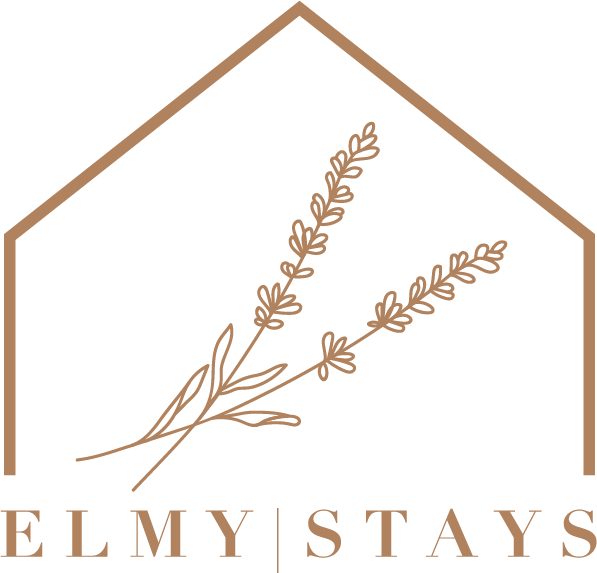 ElmyStay logo showing lavender branches inside a house.