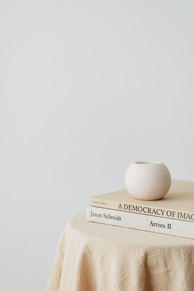 minimalistic books stacked on top of a white table