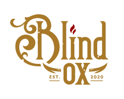 Gold and red Blind Ox logo