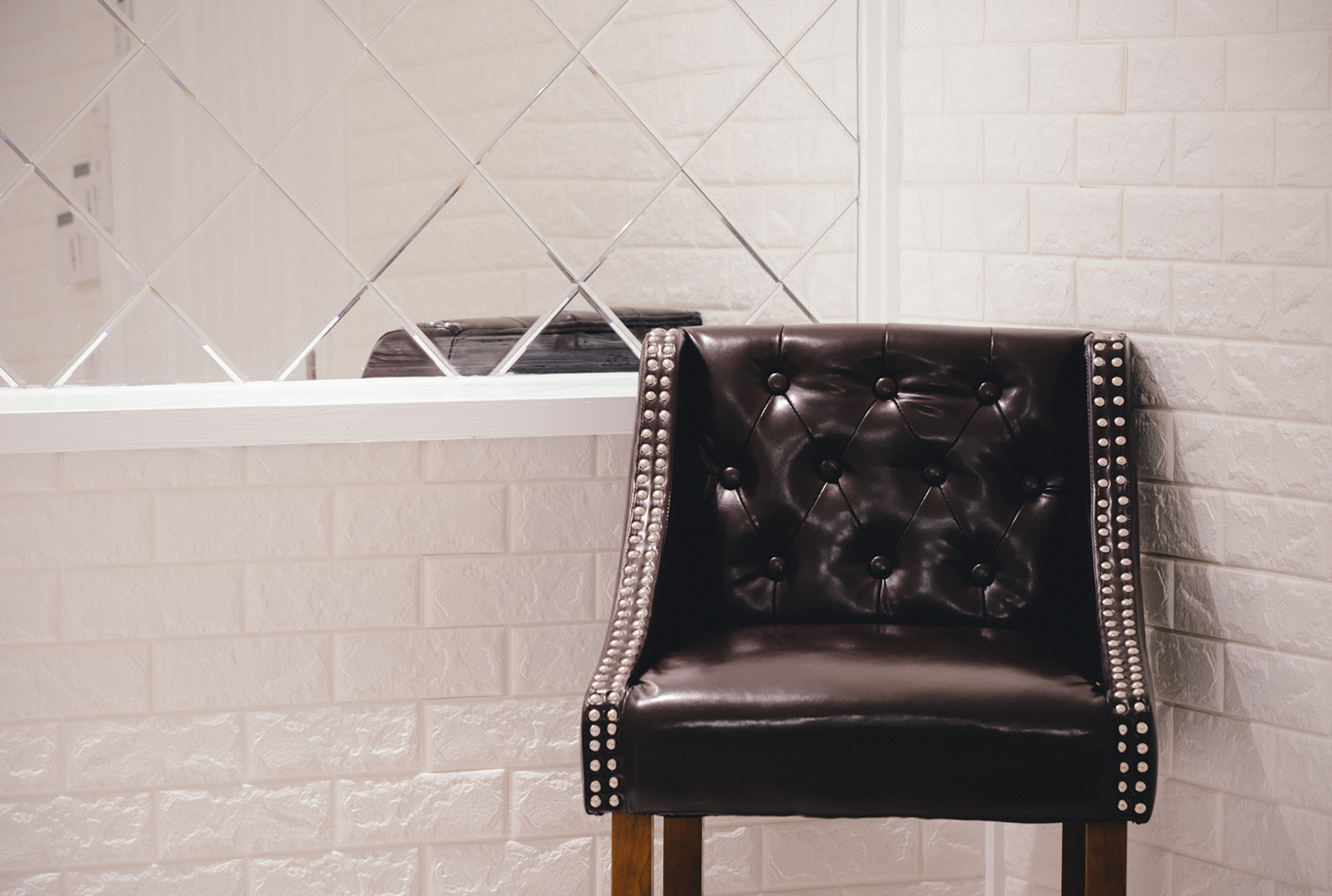 Shot of leather bar chair in private dining room