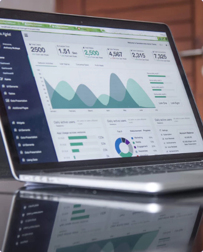 A laptop with a financial dashboard