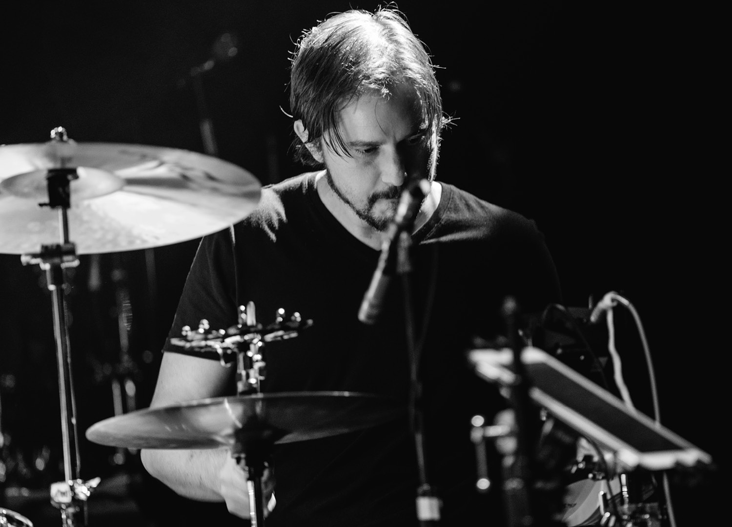 blacn and white photo of man drumming