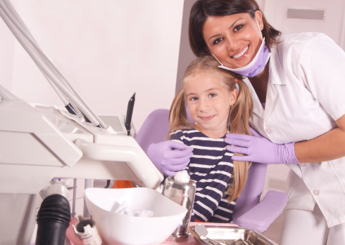 Dentist with Smiling Child Patient<br title='b11'>at Shenandoah Family Dentistry