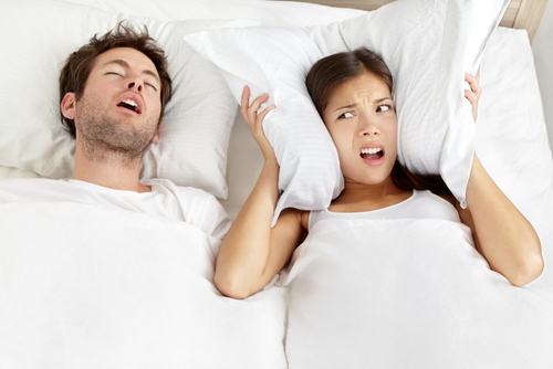 A snoring man in need of sleep apnea treatment from Shenandoah Family Dentistry