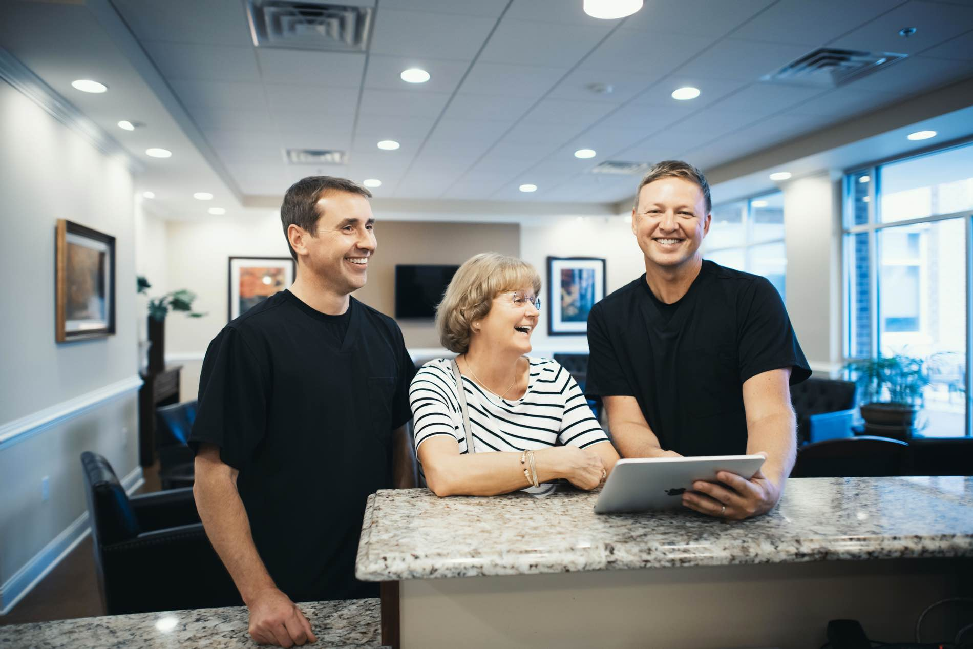 Photo of Dr. Pell & Dr. Bohrer standing with a patient