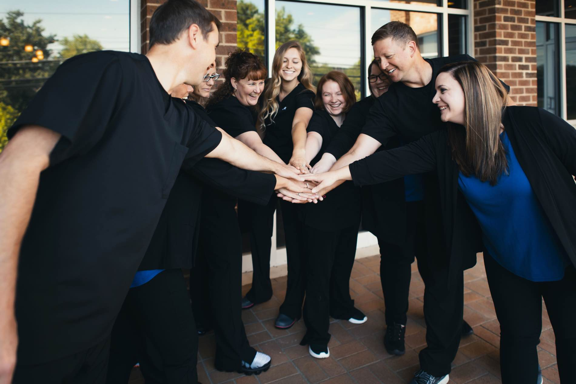 Photo of the Shenandoah team  in a circle with their hands together