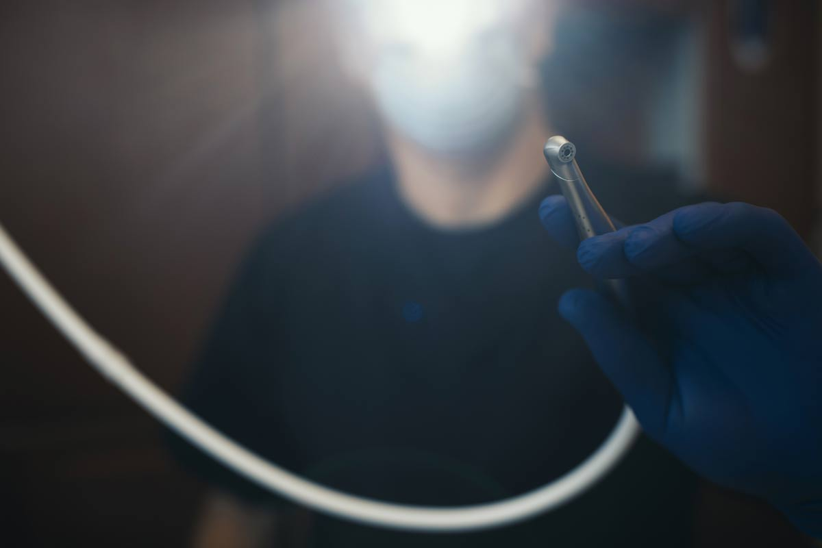 Photo of a hand holding a dental instrument