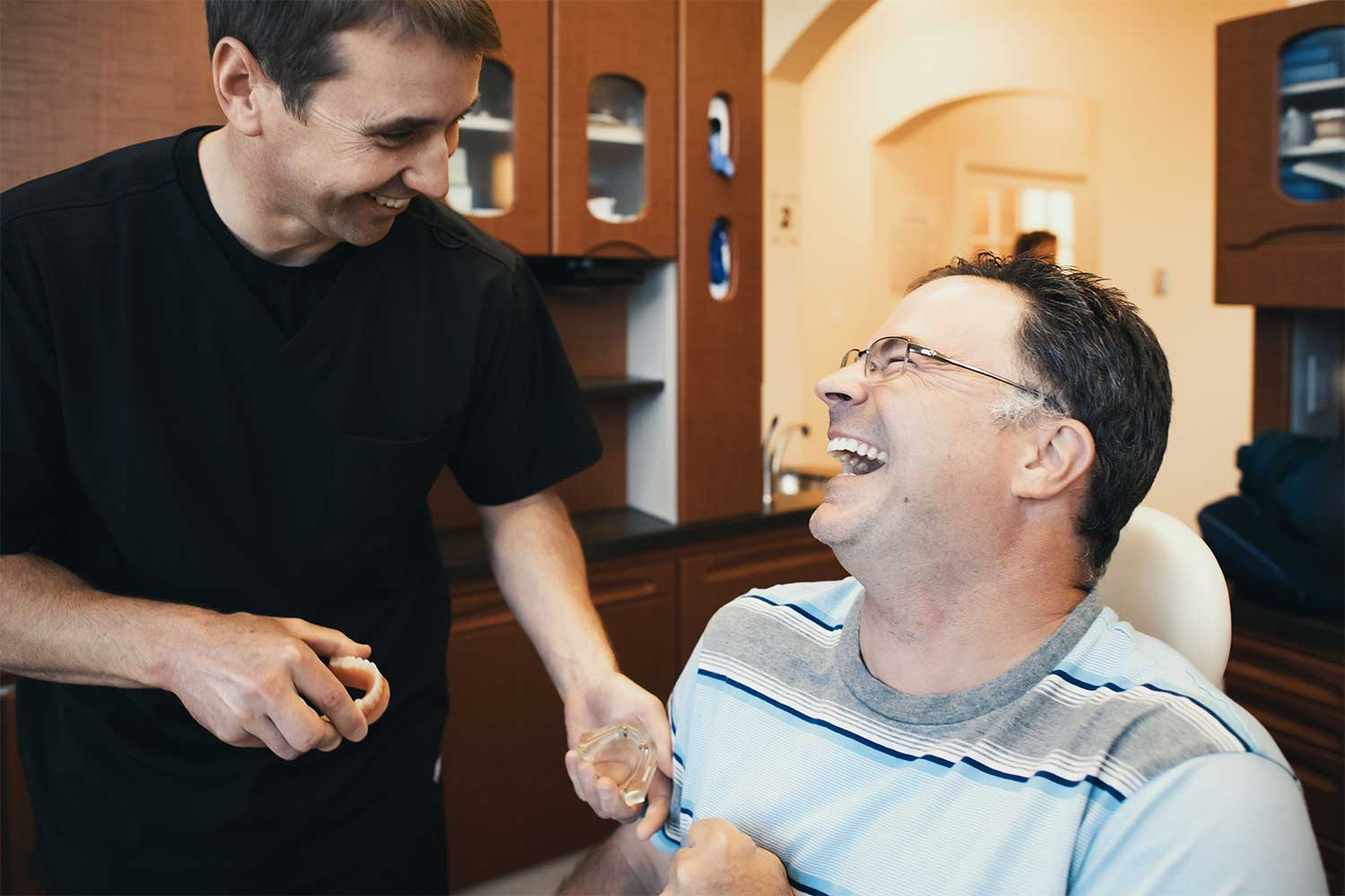 Photo of Dr. Pell laughing with a patient
