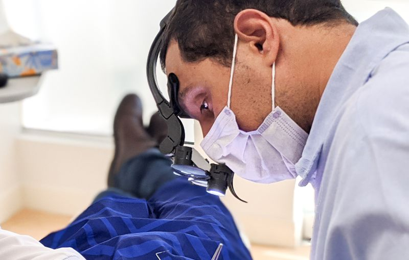 dentist cleaning teeth