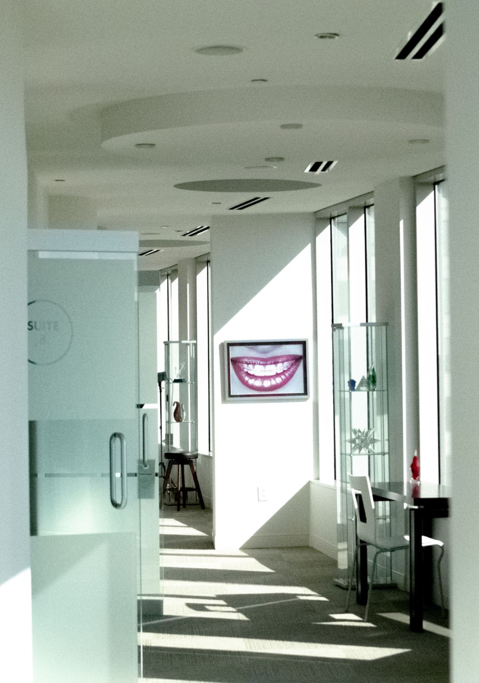 inside office with artwork and tv