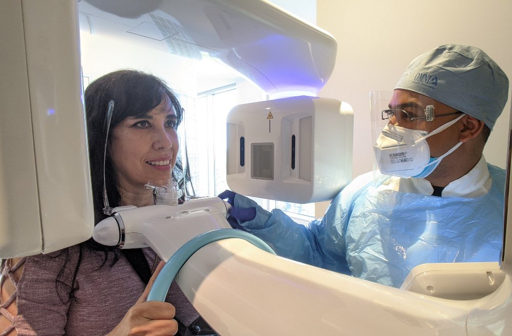 A woman getting a CBCT scan