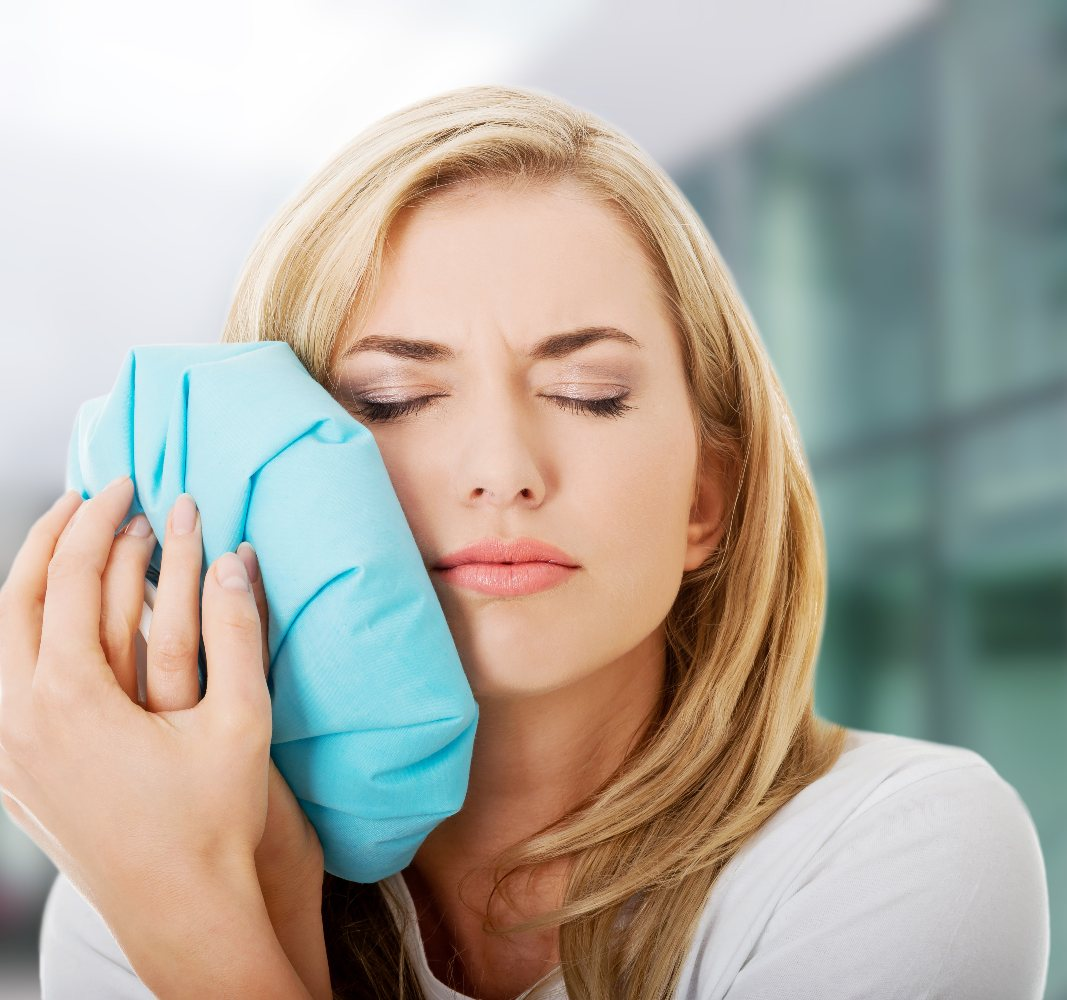 lady holding an ice pack to her face