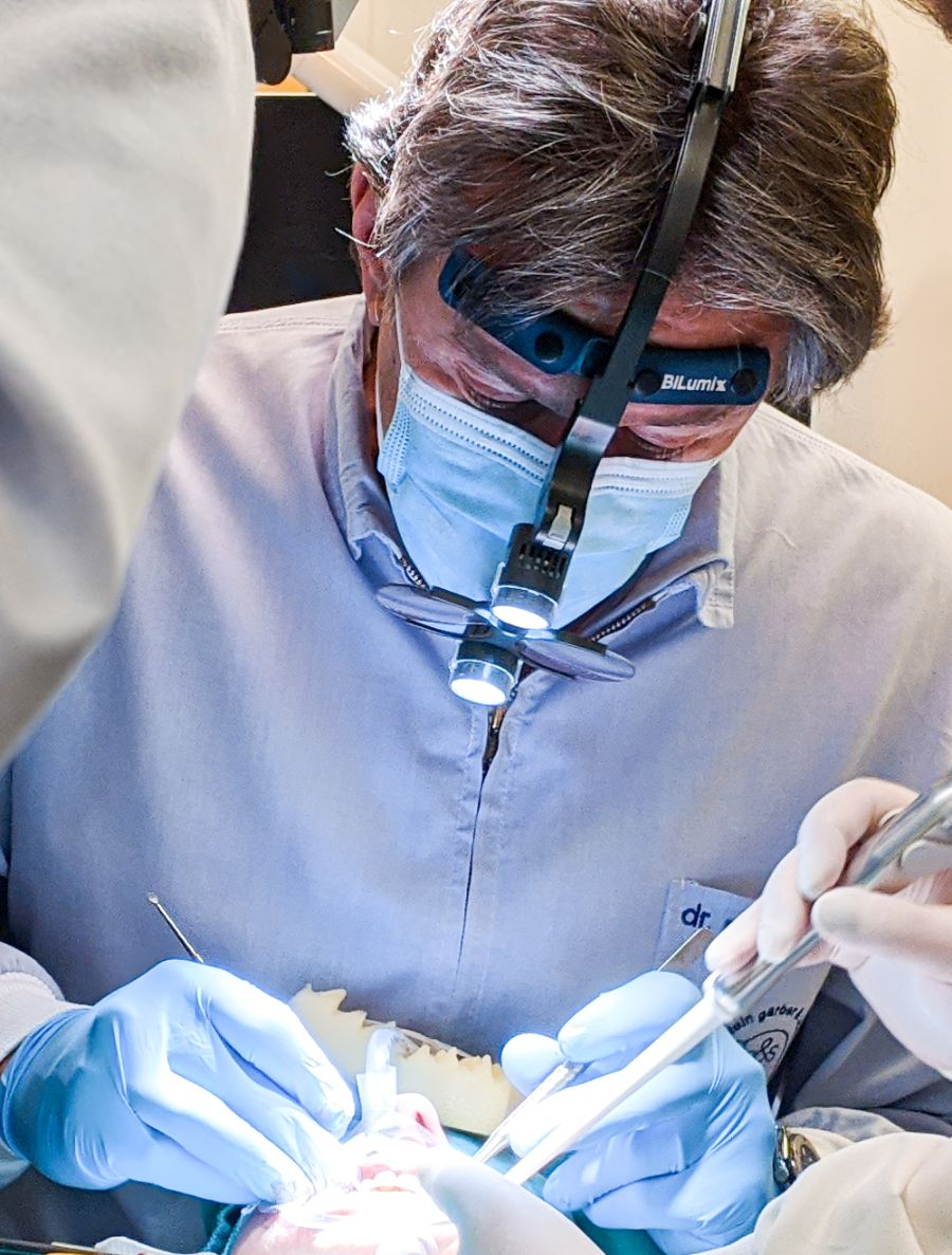 Dentist doing an oral surgery