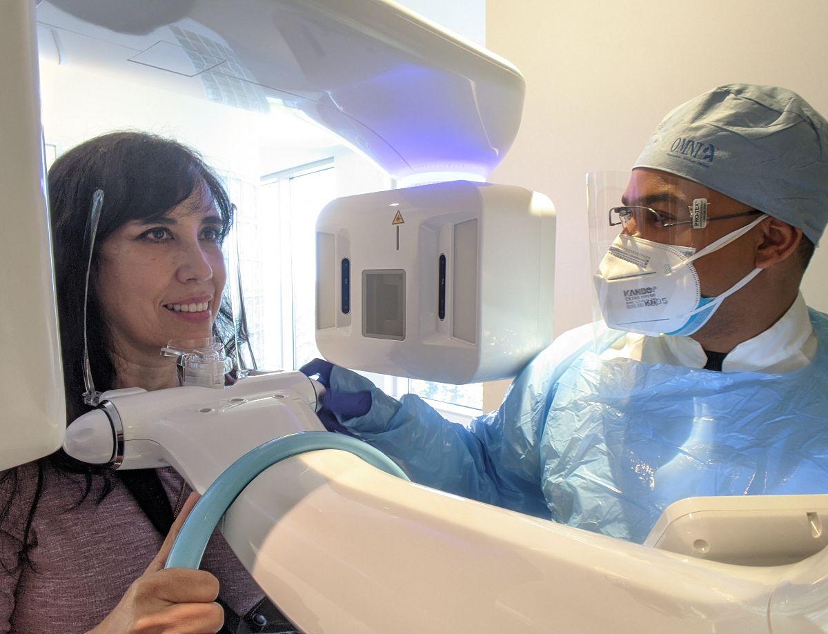 doctor taking cbct scan