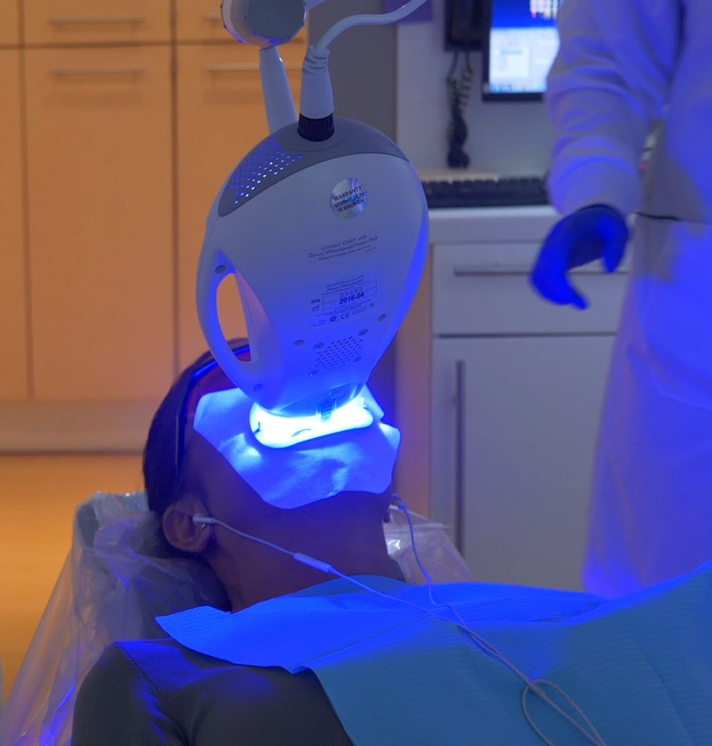 patient getting her teeth whitened with UV