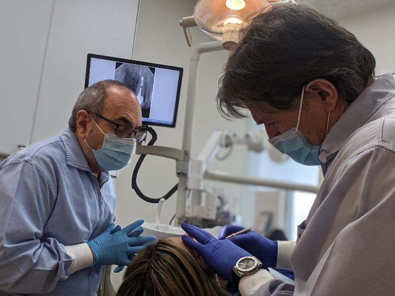 dentists cleaning teeth