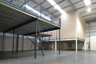 Empty warehouse with a mezzanine installed.