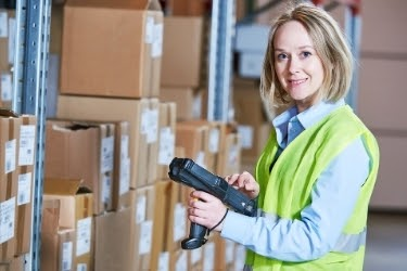 Woman holding a Warehouse Management System scanner