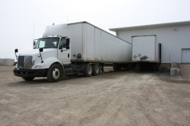 Truck parked in a warehouse facility
